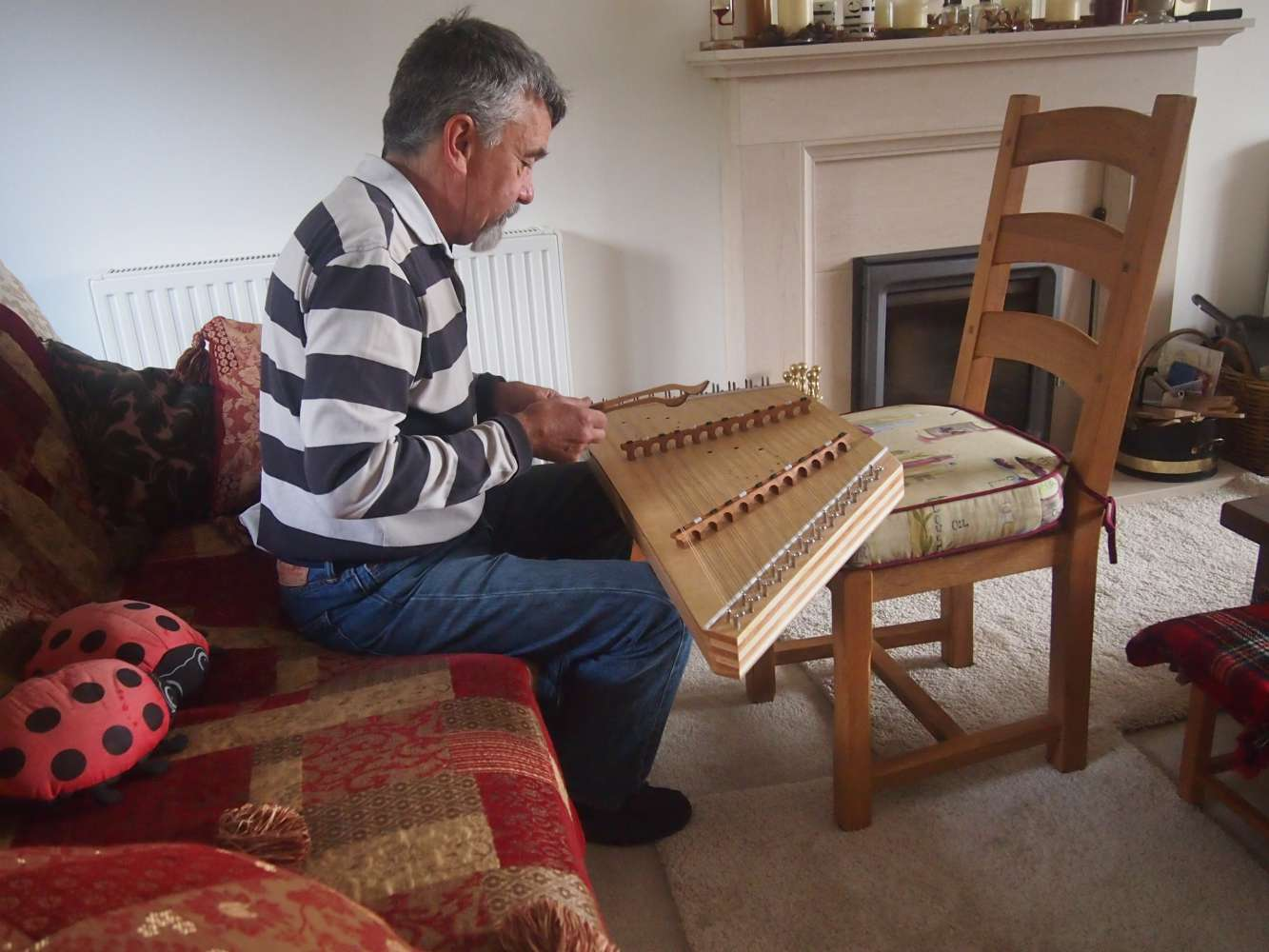 Playing the Dulcimer using a chair